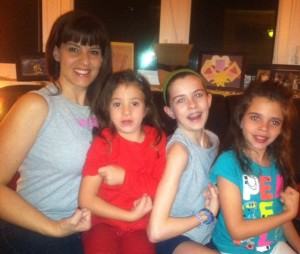"Carol with her 3 daughters, Riley, Cate and Shea...all who want ""muscles like mommy!"""